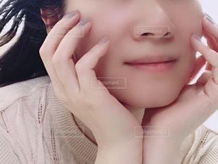 女性の顔のアップ。の写真・画像素材[1401497]