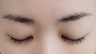 女性の顔のアップの写真・画像素材[1492326]