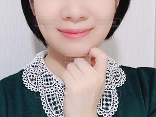 女性の顔のアップの写真・画像素材[1521647]