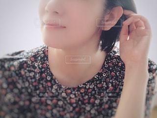 女性の顔のアップの写真・画像素材[1626906]