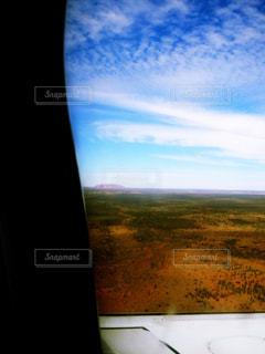 飛行機からエアーズロックが見えたの写真・画像素材[1366203]