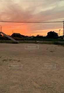 電線と、夕焼けの写真・画像素材[4845878]