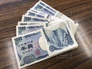 千円札の束の写真・画像素材[2406286]