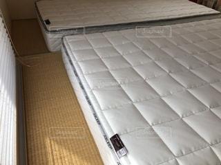 和室の畳の上にベッドマットレスの写真・画像素材[1583865]