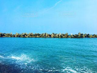 海も空、テトラポッドの写真・画像素材[2249733]
