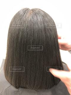 健康毛、黒髪バージンヘア、髪質改善後の髪です。広告などにおすすめです。の写真・画像素材[1843039]
