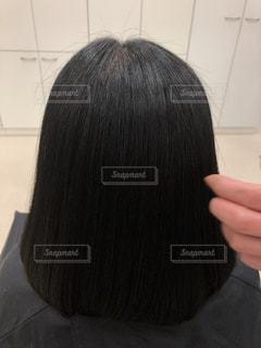 健康毛、黒髪バージンヘア、髪質改善後の髪です。広告などにおすすめです。の写真・画像素材[1843040]
