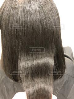 健康毛、黒髪バージンヘア、髪質改善後の髪です。広告などにおすすめです。の写真・画像素材[1843042]