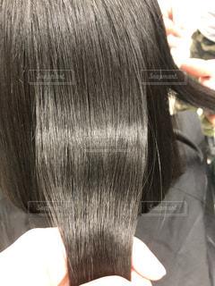 健康毛、黒髪バージンヘア、髪質改善後の髪です。広告などにおすすめです。の写真・画像素材[1843043]