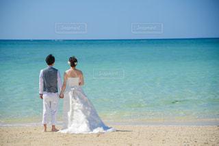 ビーチに立っている人の写真・画像素材[1450721]