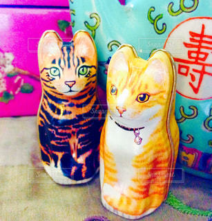 シノワズリなヴィンテージ雑貨と猫の写真・画像素材[1461291]