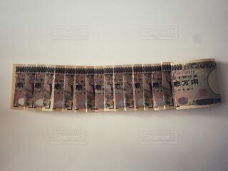一万円札で無量大数。1の後ろの0が68個の写真・画像素材[4771703]