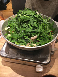 ブロッコリーと食品のボウルの写真・画像素材[1045392]