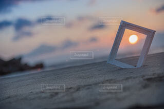 夕日を収めるの写真・画像素材[1714012]