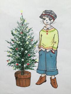 クリスマスツリーの横で、パチリ。にゃあはん。の写真・画像素材[1627241]