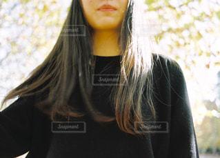 近くの女性のアップの写真・画像素材[1634067]