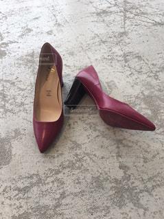 赤い靴のペアの写真・画像素材[1518845]