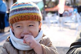 帽子をかぶった小さな男の子の写真・画像素材[1545734]