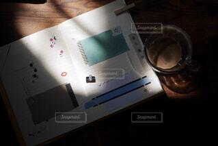 手帳とコーヒーの写真・画像素材[1849861]