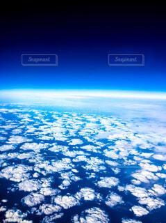 宇宙から地球のビューの写真・画像素材[1551916]