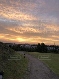 秋空の夕陽の写真・画像素材[1559643]