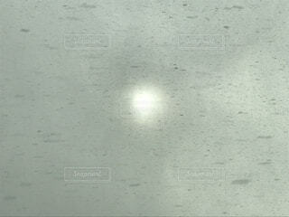 吹雪の空の太陽の写真・画像素材[1697349]