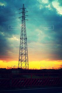 夕陽と鉄塔の写真・画像素材[1699421]