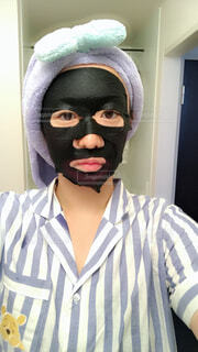 マスクを身に着けている人の写真・画像素材[1618096]