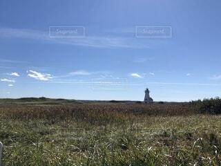 遠くに灯台の写真・画像素材[1651521]