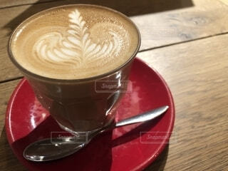 コーヒーとオレンジ ジュースのガラスのカップの写真・画像素材[1735355]