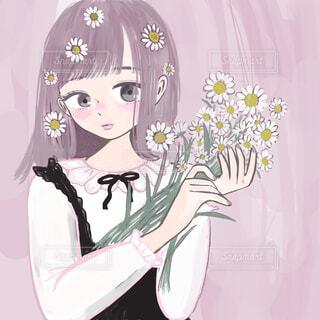 白い花を持つ少女の写真・画像素材[1692602]