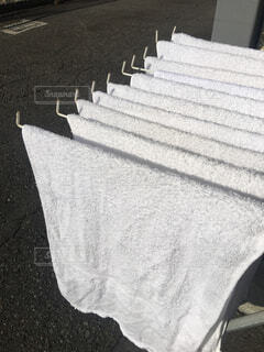 洗濯して干されたタオルの写真・画像素材[1684564]