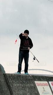 堤防釣りの人の写真・画像素材[1681996]