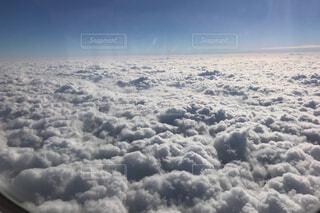 飛行機からの雲の写真・画像素材[1688654]