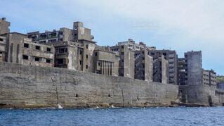 船から見た軍艦島の写真・画像素材[1725104]
