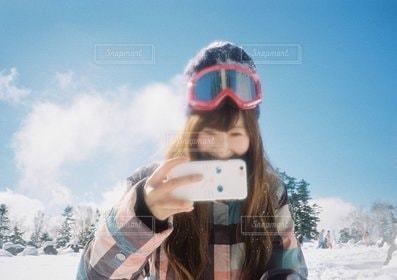 女性,1人,自撮り,ロングヘア,スポーツ,スマホ,人物,スキー,スノボ,ゲレンデ,撮り合い,スキー場