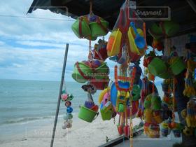 海,空,夏,南国,ビーチ,カラフル,屋台,水辺,アジア,バケツ,おもちゃ,タイ,浮き輪,ポップ,シャベル